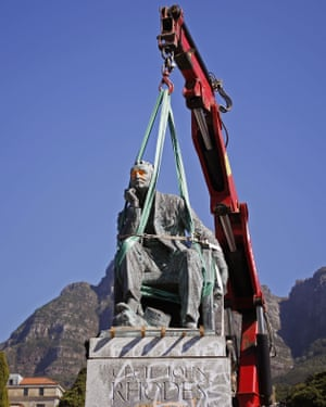 A statue of Cecil Rhodes is removed at Cape Town University after weeks of protest by students.