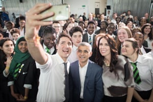Justin Trudeau, Sadiq Khan and Jacinda Ardern take a selfie in London, UK