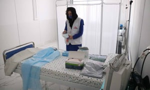 A staff member from international medical aid charity Médecins Sans Frontières attends the inauguration ceremony of a 100-bed hospital designed for coronavirus patients in Herat, northwestern Afghanistan.