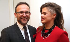 The Greens MP Adam Bandt with his partner Claudia Perkins, who wore a 'coal kills' message in her hair and on her necklace