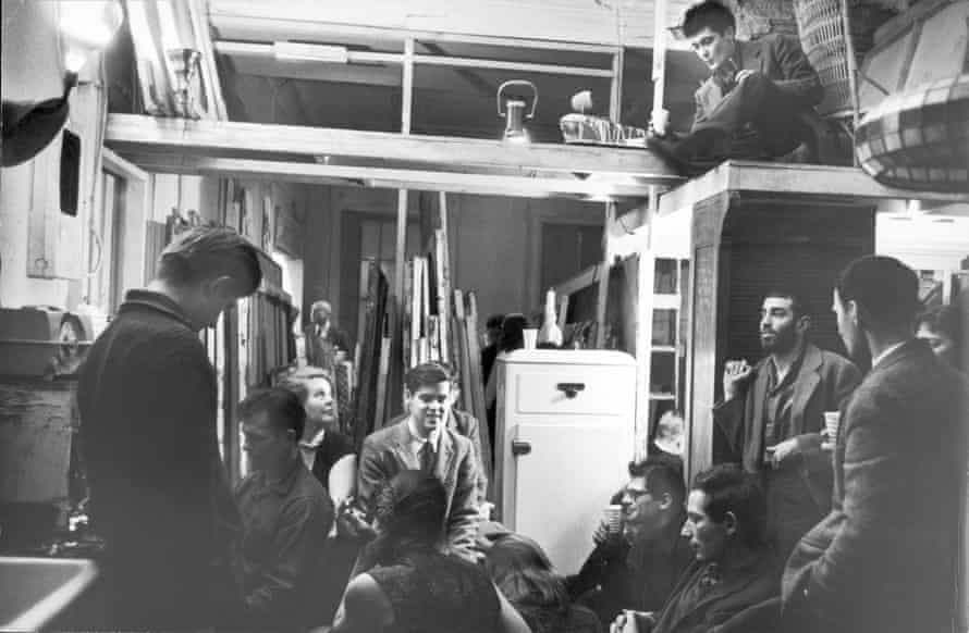 A party in Greenwich Village in 1959 with (from left) Peter Orlovsky, Jack Kerouac, Alice Neel, unidentified, Allen Ginsberg (in glasses, centre), art dealer Richard Bellamy (sitting on loft), Gert Berliner, unidentified 'Big Table' writer, and Jonas Mekas (back to camera).