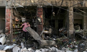 A man inspects damaged shops after an airstrike in Syria. Friday's statement by the US military about civilian casualties during strikes did not include 16 announced in January.