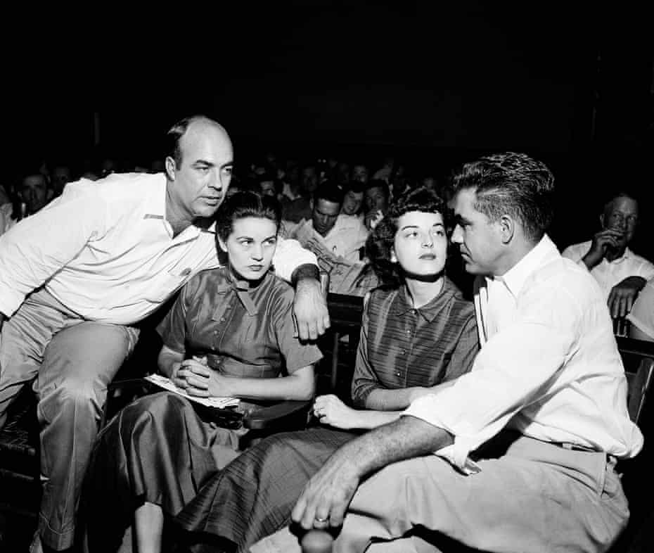 In this Sept. 23, 1955, file photo. J.W. Milam, left, and Roy Bryant, right, sit with their wives in a courtroom in Sumner, Miss. Milam and Bryant were acquitted of murder in the slaying of Emmett Till.