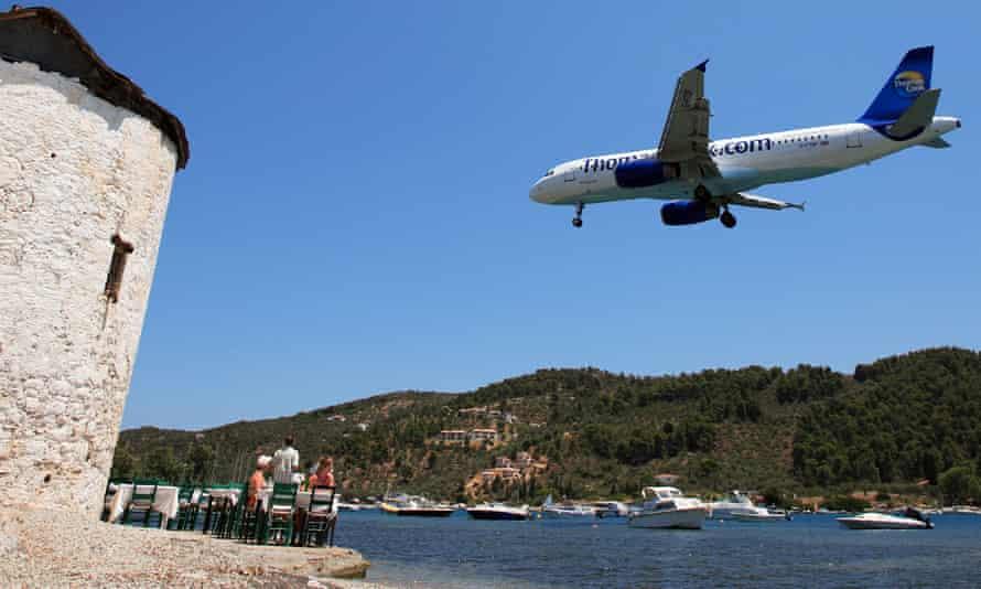 A Thomas Cook holiday charter jet prepares to land on Skiathos
