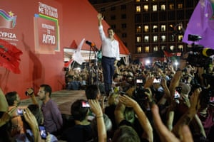 Alexis Tsipras, head of the left-wing Syriza party waves to his supporters after his general election victory, at Syriza's party's main electoral center in Athens.