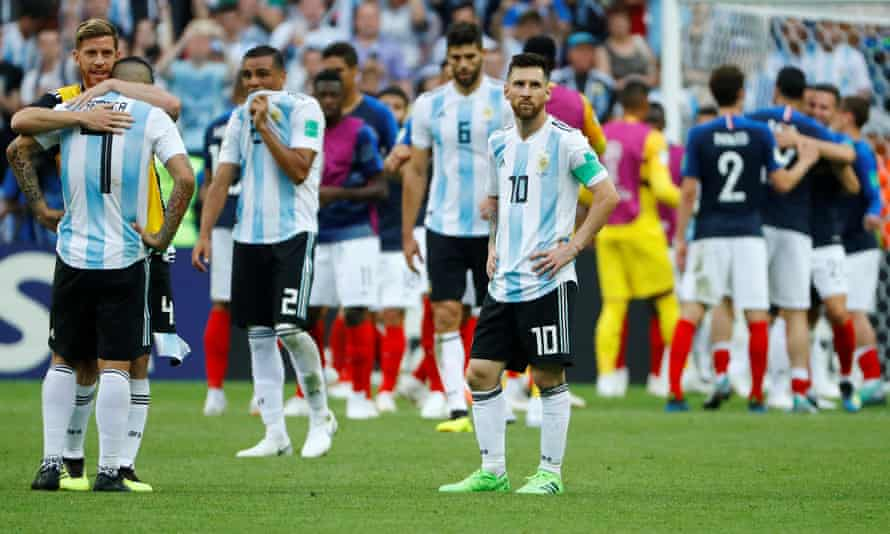 Lionel Messi and his team-mates look dejected after the match.