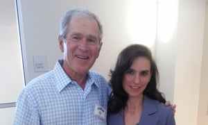 George W Bush poses for a picture with court interpreter Terrell Eustice at the courthouse