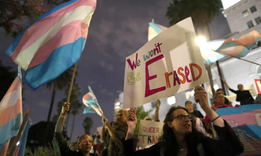 People protest the Trump administration's reported effort to redefine gender in Los Angels, California, on 22 October.