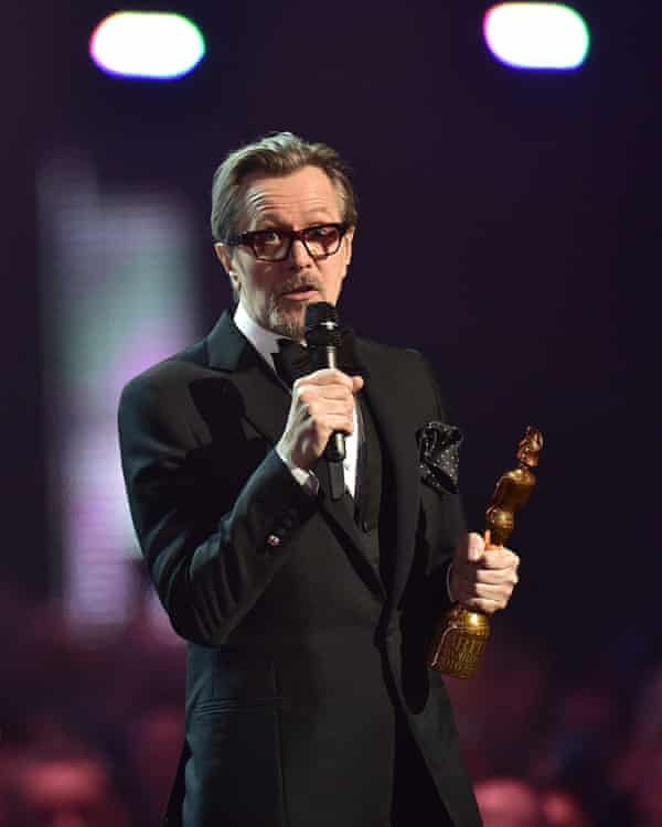 Leading the tribute … Gary Oldman collected the Icon award for David Bowie at this year's Brit awards.