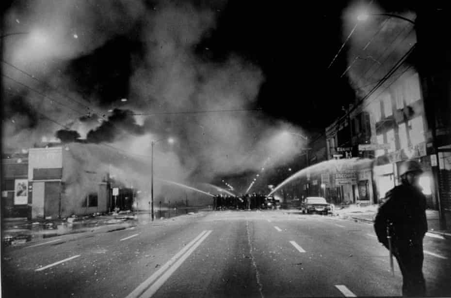 Chicago firemen fight blazes during race riots following murder of Martin Luther King.