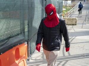 A Spider-Man mask and gloves near the Coney Island boardwalk, in Brooklyn, New York