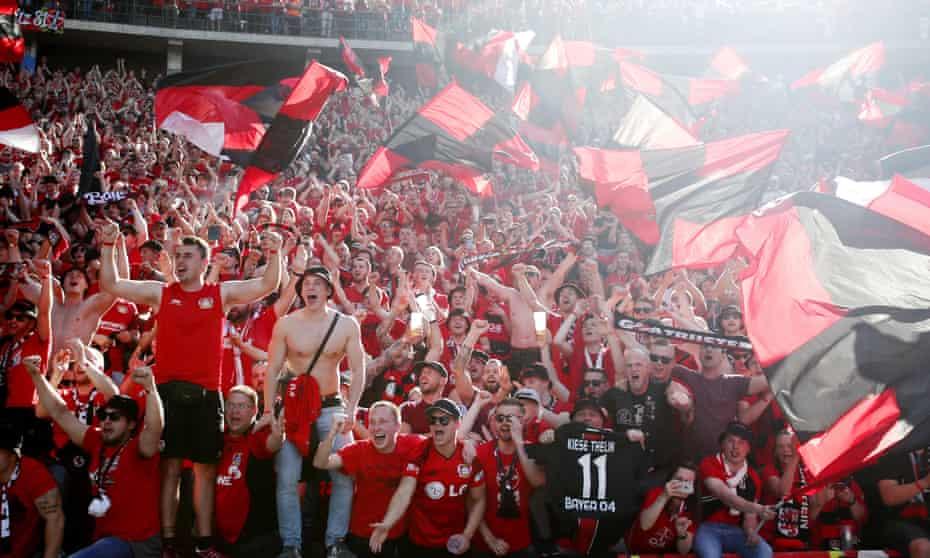 Bayer Leverkusen fans celebrate.