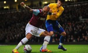 Julien Faubert, after returning to West Ham, battles with Adam Lallana.