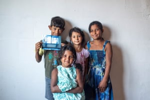 From left to right: Ercan, Sania, Belfina and Medina, back in Macedonia, pose with the picture of two trapped foxes they helped safe while living in Berlin.