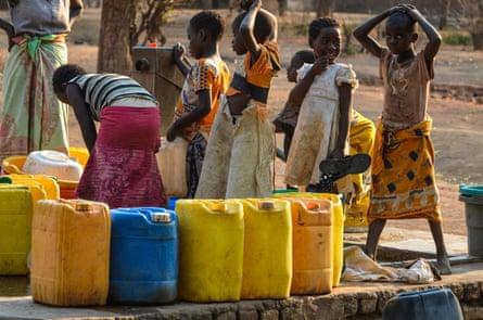 Little girls fetch water in Kachaso village, Nsanje district, Malawi