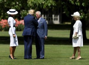 Britain's Prince Charles, and Camilla, Duchess of Cornwall meet US President Donald Trump, second left, and his wife Melania as they arrive at Buckingham Palace