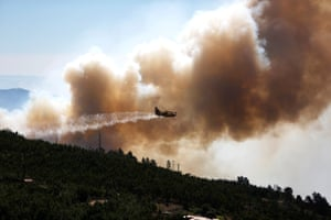 A plane drops water on a fire near the village of Monchique