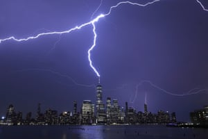 Lightning strikes the One World Trade Center in New York during a thunderstorm, as seen from Jersey City