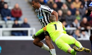 Everton's Jordan Pickford brings down Salomon Rondon to concede a penalty during the defeat at Newcastle. He saved the penalty and avoided sanction from the referee.