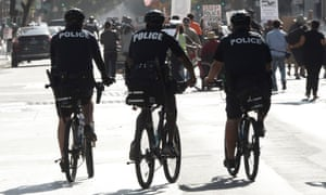LAPD bicycle officers follow a march in downtown Los Angeles.