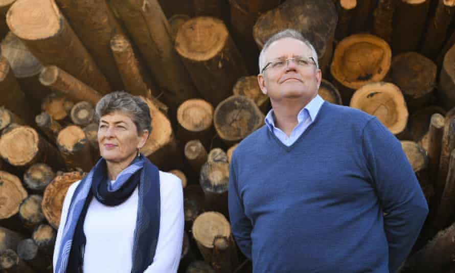 Liberal party candidate for the seat of Eden-Monaro, Fiona Kotvojs, with PM Scott Morrison during a visit to a woodchip mill near Eden on Tuesday.