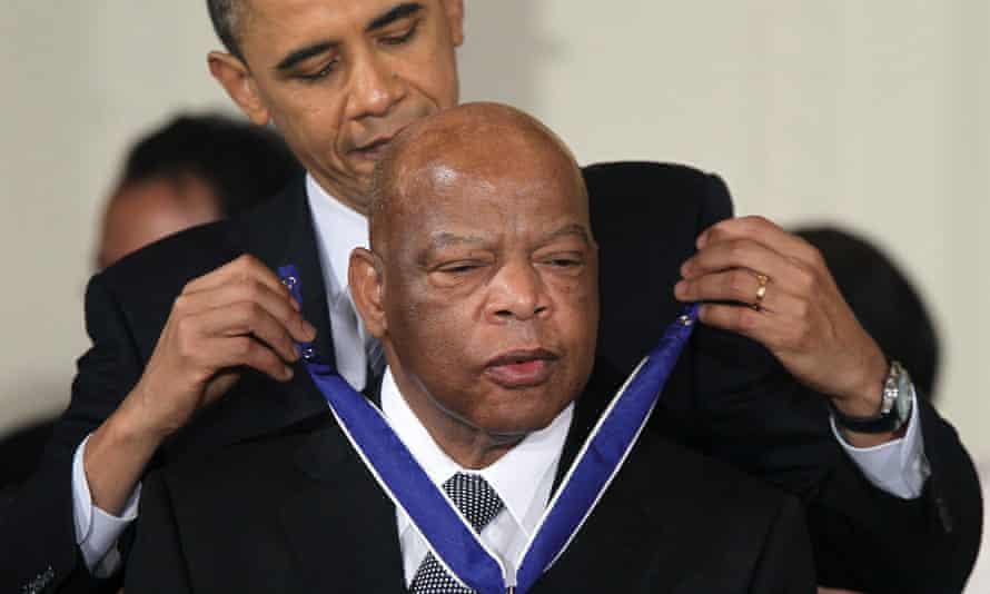 John Lewis is presented with the Medal of Freedom by Barack Obama in 2010