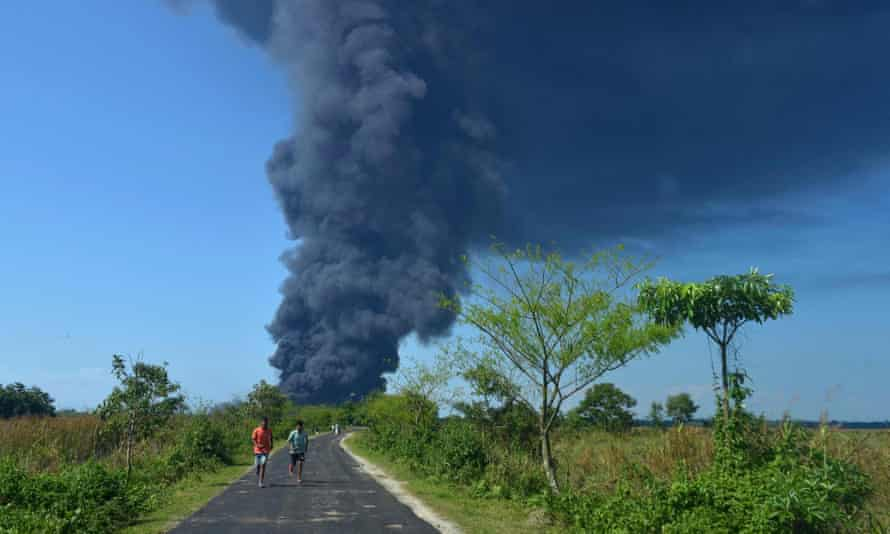 A plume of smoke rises following an explosion at an oil well operated by the state owned Oil India in Baghjan in the northeast Indian state of Assam