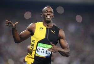 Usain Bolt celebrates winning his third 100m gold.