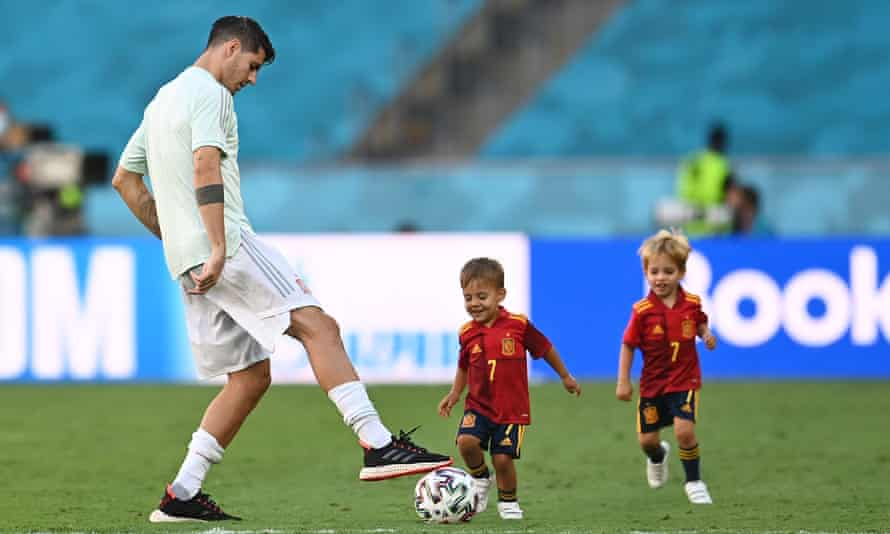 Álvaro Morata plays football with two of his children after Spain's win against Slovakia at Euro 2020.