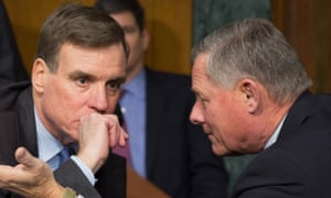 Mark Warner and Richard Burr in conversation in January. The two have found 'no indication' Barack Obama wiretapped Donald Trump.