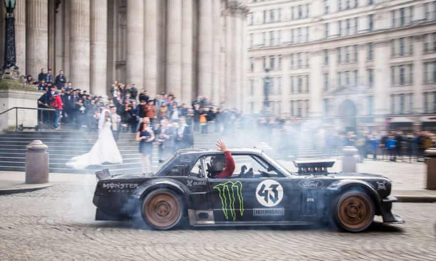 Matt LeBlanc waves to a bride and groom at St Paul's cathedral in London as he and Ken Block drive past in controversial Top Gear filming.