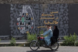 A mural in central Kabul of a hand grenade with a man and woman dancing inside it.