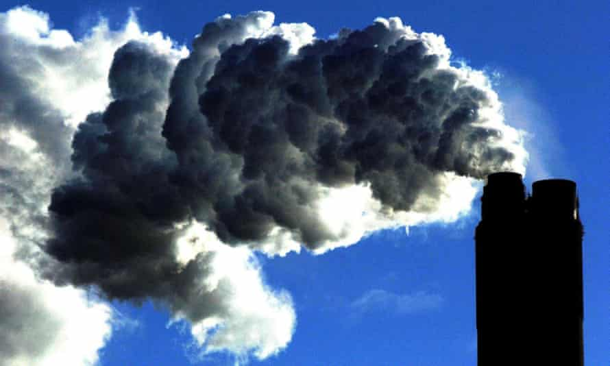 A coal-fired power plant with emissions blowing