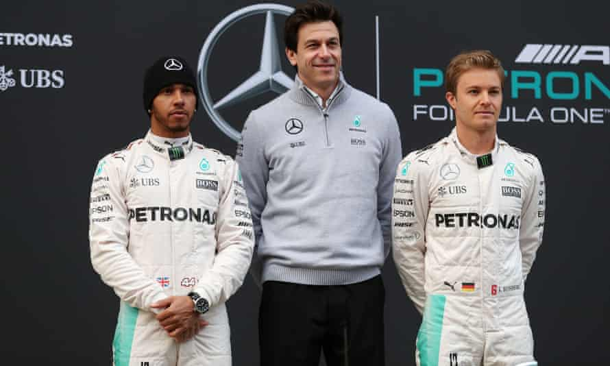 The Mercedes team principal, Toto Wolff, with Lewis Hamilton and his then teammate Nico Rosberg.