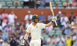 Australian batsman Travis Head raises his bat after scoring a half century on day two of the first Test in Adelaide.