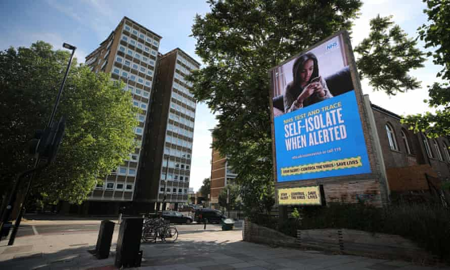 A government and NHS test and trace advert is seen on a billboard in London