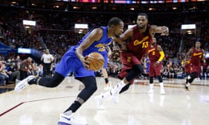 Golden State Warriors forward Kevin Durant drives to the basket against Cleveland Cavaliers forward Tristan Thompson at Quicken Loans Arena.