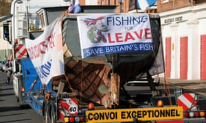 A 30ft fishing boat on a lorry is escorted by a Pipe band as a flotilla of fishing boats from the Fishing For Leave protest group prepares to sail up the River Tyne from North Shields.