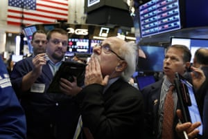 Peter Tuchman, center, works with fellow traders on the floor of the New York Stock Exchange today