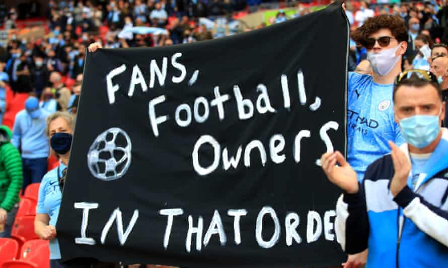 Manchester City fans display a banner before the Carabao Cup final against Tottenham in April.