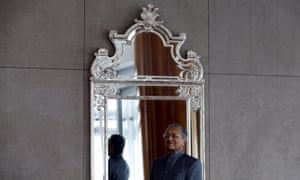 Malaysia's former prime minister Mahathir Mohamad poses for a photograph following an interview with Reuters at his office in Petronas Towers, Kuala Lumpur,