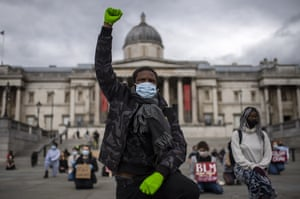 Protesters kneel in Trafalgar Square in support of Black Lives Matter.