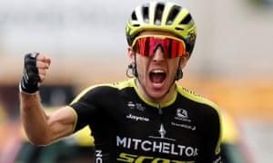 Simon Yates celebrates after crossing the line in Bagnères-de-Bigorre