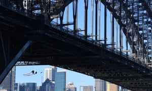 Greenpeace activists suspended underneath the Harbour Bridge in a climate change protest
