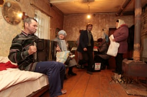 Electoral officials visit villagers in Gryaz, 290 miles from Moscow, during Russian parliamentary elections that are expected to to test Vladimir Putin's popularity.