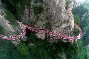 Luoyang, China. A banquet is held along the walkway of a cliff in Henan province