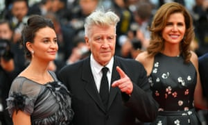 US director David Lynch (C), his wife Emily Stofle (L) US producer Desiree Gruber pose as they arrive on May 25, 2017 for the screening of the tv series 'Twin Peaks' at the 70th edition of the Cannes Film Festival in Cannes, southern France