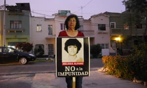 Norma Mendez holds a picture of Melissa Alfaro, a journalist who was killed in Peru's 'dirty war' during the reign of Alberto Fujimori in early 1990s.