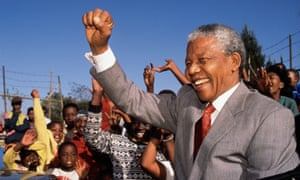 Rags to riches … Mandela visits a Johannesburg school.