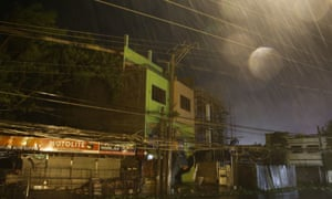 Strong winds and rain batter buildings in Tuguegarao city.